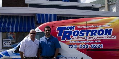 Tom Rostron and Tom Rostron Jr with Service Truck